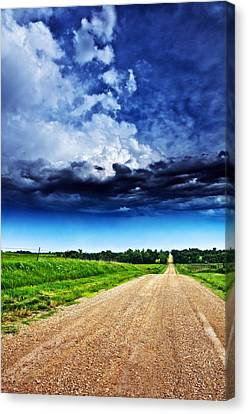 Forming Clouds Over Gravel Canvas Print