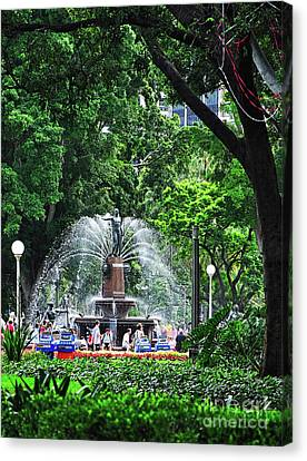 Canvas Print featuring the photograph Fountain Through The Trees By Kaye Menner by Kaye Menner