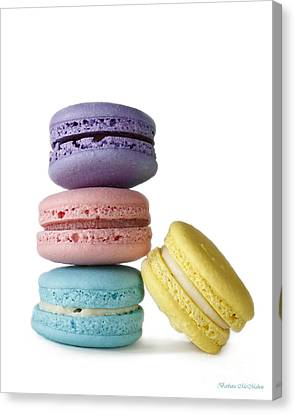 Four Delicate Macarons Canvas Print by Barbara McMahon