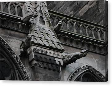 Canvas Print featuring the photograph Four Gargoyles On Notre Dame North by Christopher Kirby