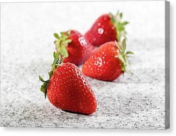 Four Strawberries Canvas Print - Four Juicy Strawberry On Granite Background by Piotr Marcinski