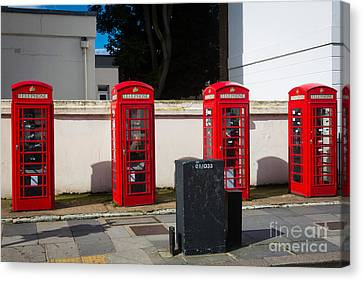 Four Phone Booths In London Canvas Print by Inge Johnsson