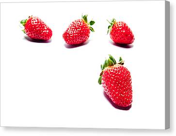 Four Strawberries Canvas Print