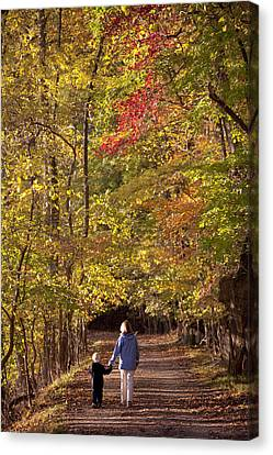 Four Year Old Boy And His Mom Walk Hand Canvas Print by Skip Brown