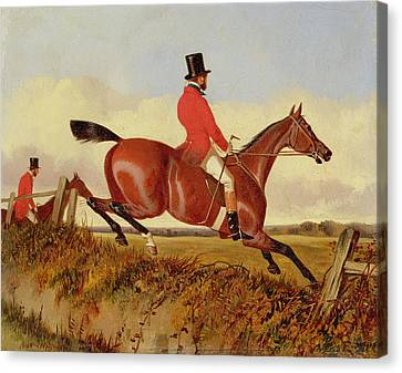 Foxhunting - Clearing A Bank Canvas Print by John Dalby