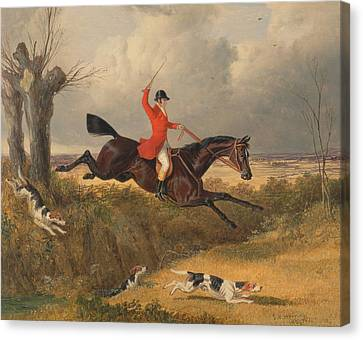 Foxhunting Clearing A Ditch Canvas Print by John Frederick Herring