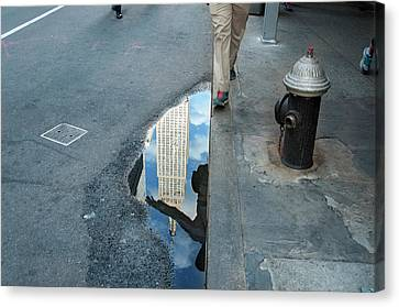 Free In Manhattan - Man Hopping Over A Puddle Canvas Print