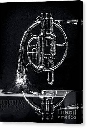 French Horn Beyond A Glass Table Canvas Print by James Aiken