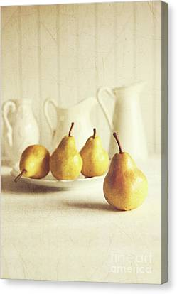 Fresh Pears On Old Wooden Table Canvas Print by Sandra Cunningham