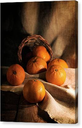Fresh Tangerines In Brown Basket Canvas Print by Jaroslaw Blaminsky