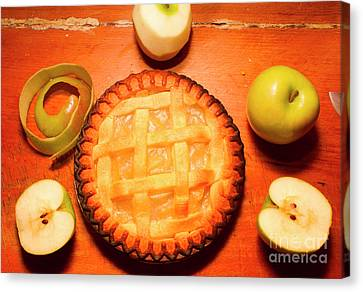 Freshly Baked Pie Surrounded By Apples On Table Canvas Print