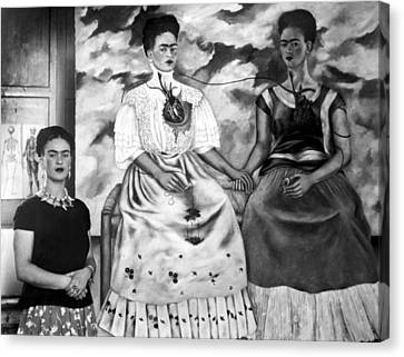 Frida Kahlo Shown With Her Painting Me Canvas Print by Everett