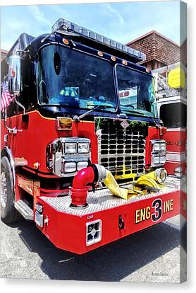 Helmets Canvas Print - Front Of Fire Truck With Hose by Susan Savad