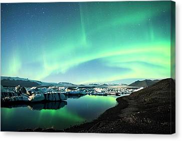 Canvas Print featuring the photograph Frozen Auroras by Brad Scott