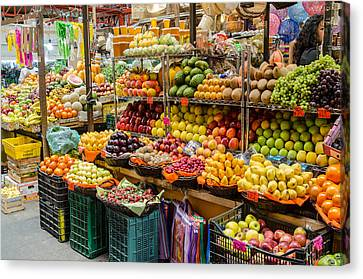 Fruit Stall In A Guanajuato Market, Canvas Print by Rob Huntley