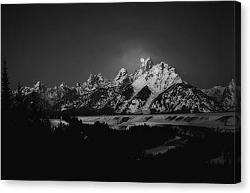 Full Moon Sets In The Tetons Canvas Print by Raymond Salani III