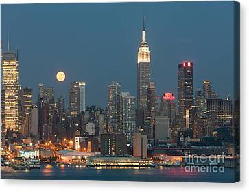 Full Moon Rising Over New York City II Canvas Print by Clarence Holmes