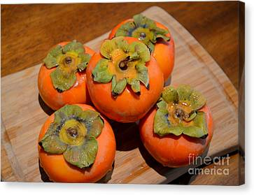 Fuyu Persimmons Ready To Slice Canvas Print by Mary Deal