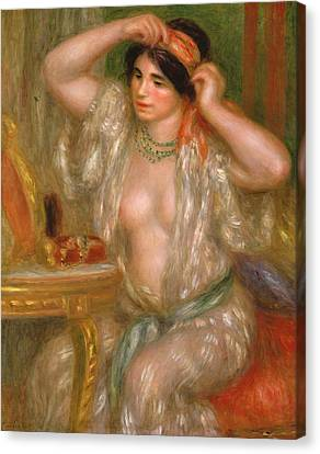 Gabrielle At The Mirror Canvas Print by Pierre Auguste Renoir