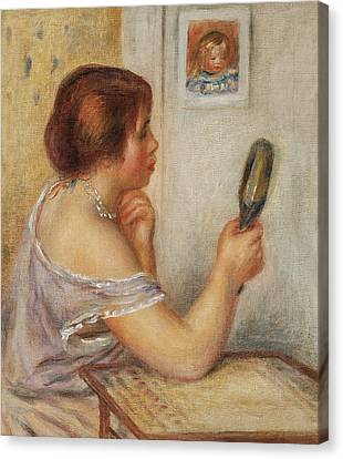Gabrielle Holding A Mirror Or Marie Dupuis Holding A Mirror With A Portrait Of Coco Canvas Print by Pierre Auguste Renoir
