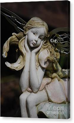 Canvas Print featuring the photograph Garden Fairy by Lila Fisher-Wenzel
