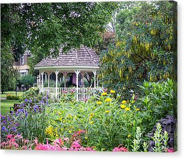 Gazebo With Summer Blooms Canvas Print by Kari Yearous