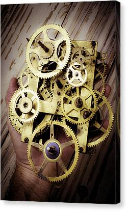 Gears Held By Hand Canvas Print by Garry Gay