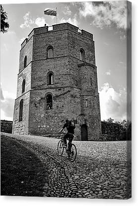 Gediminas Tower And Bicycler Lithuania Canvas Print by Mary Lee Dereske