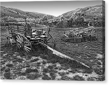 Ghost Wagons Of Bannack Montana Canvas Print by Daniel Hagerman
