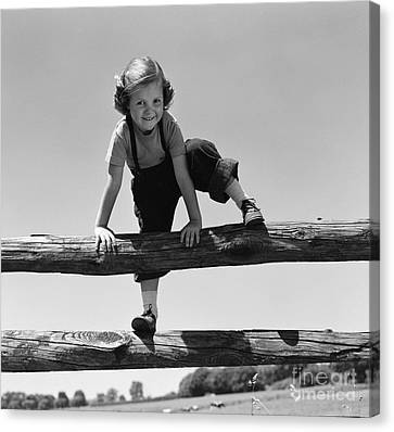 Tomboy Canvas Print - Girl Climbing Over Wooden Fence by H. Armstrong Roberts/ClassicStock