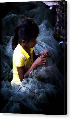 Girl Fixing Nets Canvas Print by Georgia Fowler
