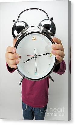 Girl Holding Alarm Clock Over Face Canvas Print by Sami Sarkis