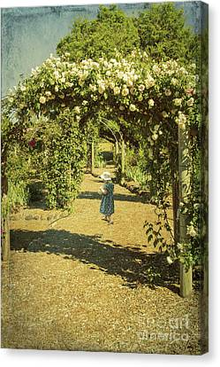 Girl In A Rose Garden Canvas Print by Elaine Teague