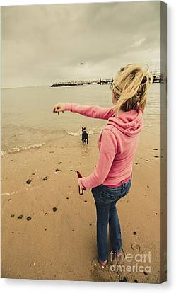 Girl Playing Fetch On Overcast Day Canvas Print