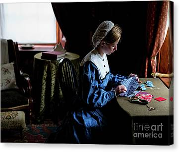 Girl Sewing Canvas Print by M G Whittingham