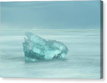 Glacial Iceberg Seascape. Canvas Print by Andy Astbury
