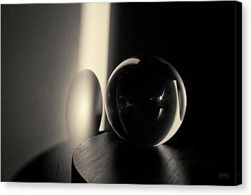 Glass Sphere In Light And Shadow Toned Canvas Print by David Gordon