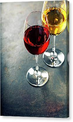 Glasses Of White And Red Wine Canvas Print by Natalia Klenova