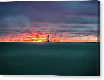 Glowing Sunset On Lake With Lighthouse Canvas Print by Lester Plank