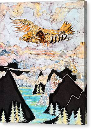Golden Eagle Flies Above Clouds And Mountains Canvas Print by Carol  Law Conklin
