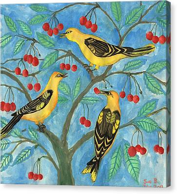 Golden Orioles In A Cherry Tree Canvas Print by Sushila Burgess