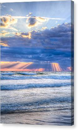 Golden Rays In Blue Canvas Print by Debra and Dave Vanderlaan
