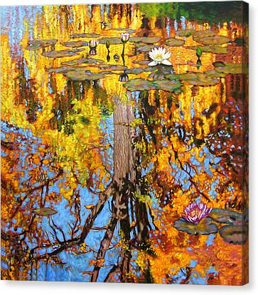 Golden Reflections On Lily Pond Canvas Print by John Lautermilch