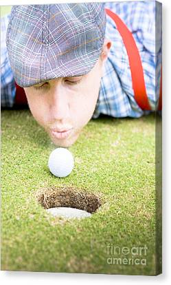 Golf Player Blowing The Ball Canvas Print by Jorgo Photography - Wall Art Gallery