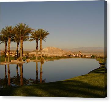 Golfing Oasis Canvas Print by Larry Underwood