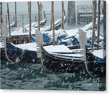 Gondolas In Venice During Snow Storm Canvas Print by Michael Henderson