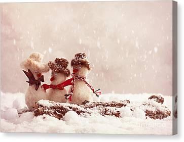 Gossiping Snowmen Canvas Print by Amanda Elwell