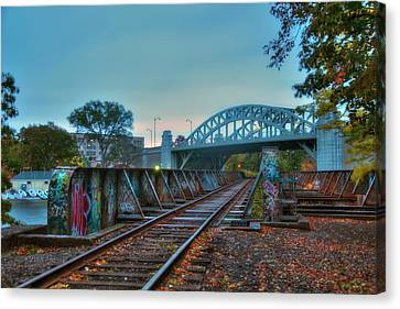 Graffiti On Train Tracks Under The Bu Bridge - Cambridge Canvas Print by Joann Vitali