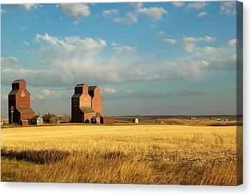 Grain Elevators Stand In A Prairie Canvas Print