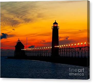 Grand Haven Sunset Canvas Print by Nick Zelinsky